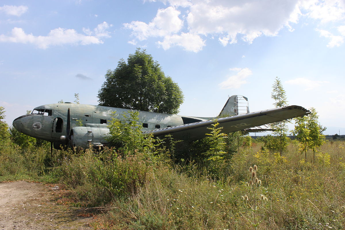 1200px-Dakota_71212_derelict_at_Željava_Airbase_(4970774781)