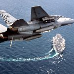 F-14 Flies Over Aircraft Carrier