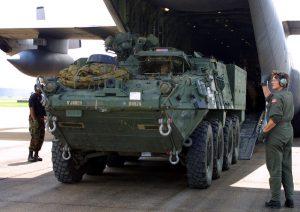 Stryker unloading from C-130