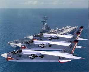 F-8 Crusaders Fly in Formation Over Carrier