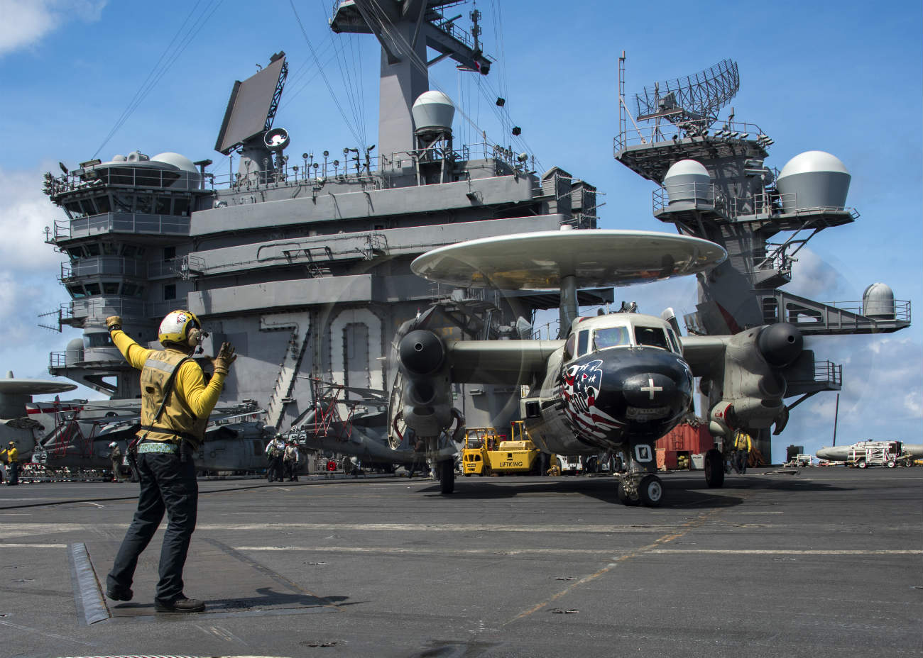 Air man directing on aircraft carrier images
