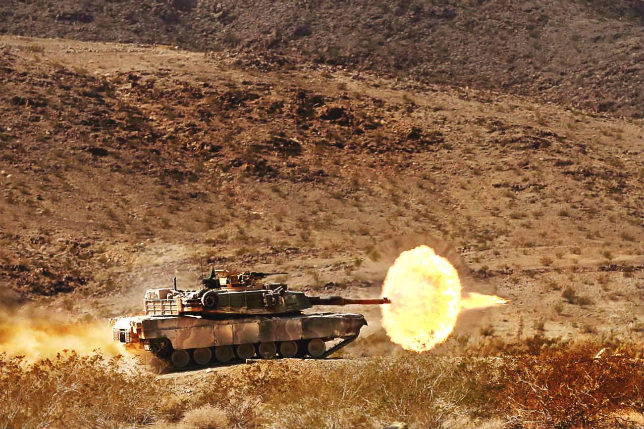 Battle tank fires M1 Abrams