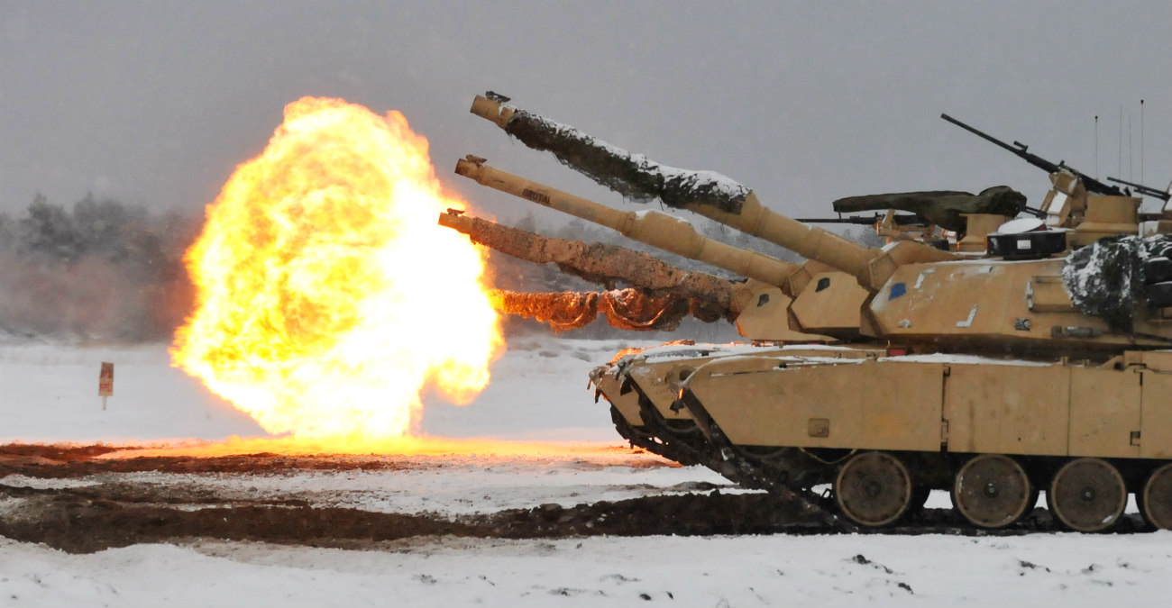 Battle tanks firing rounds