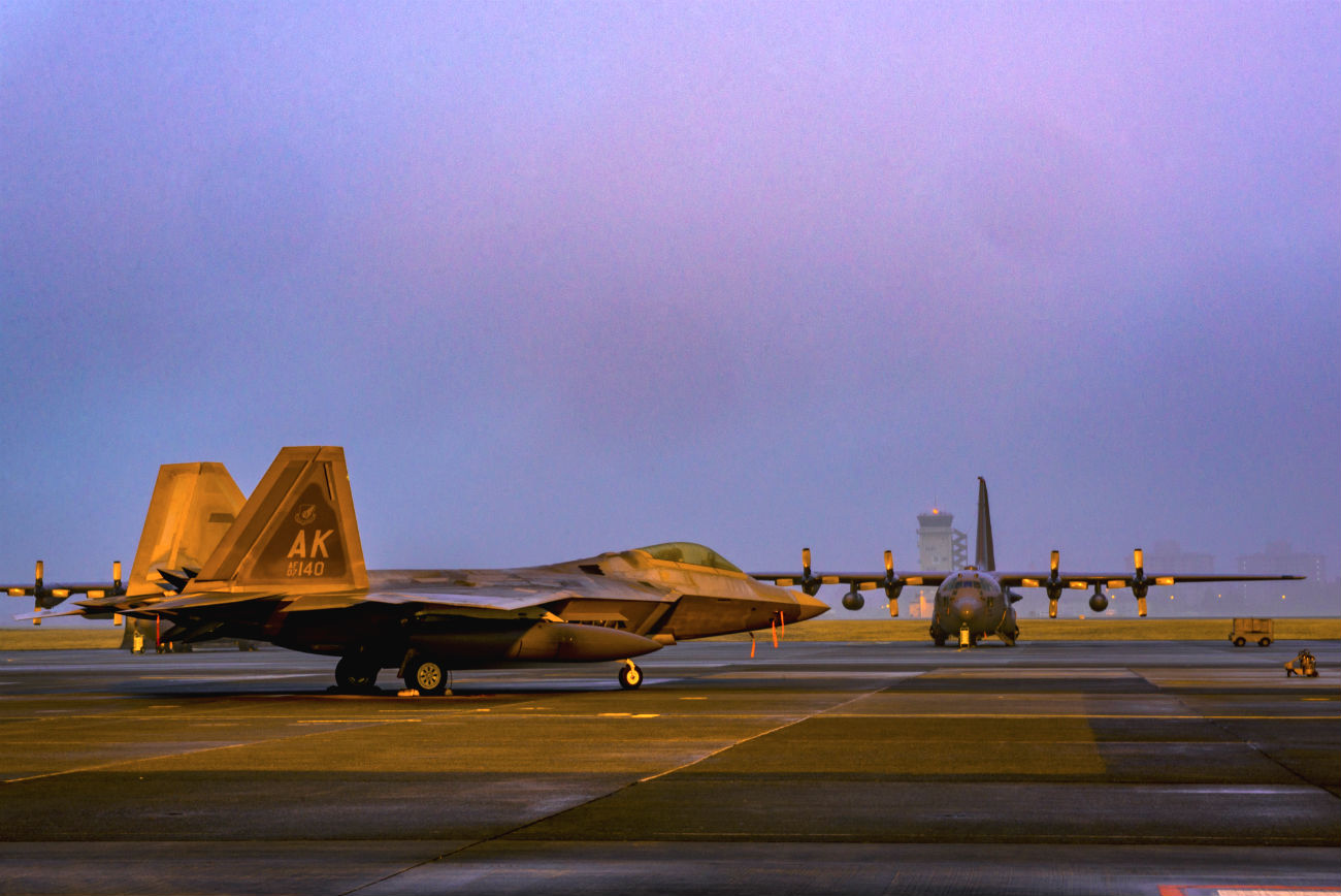 F-22 Raptor With C-130s