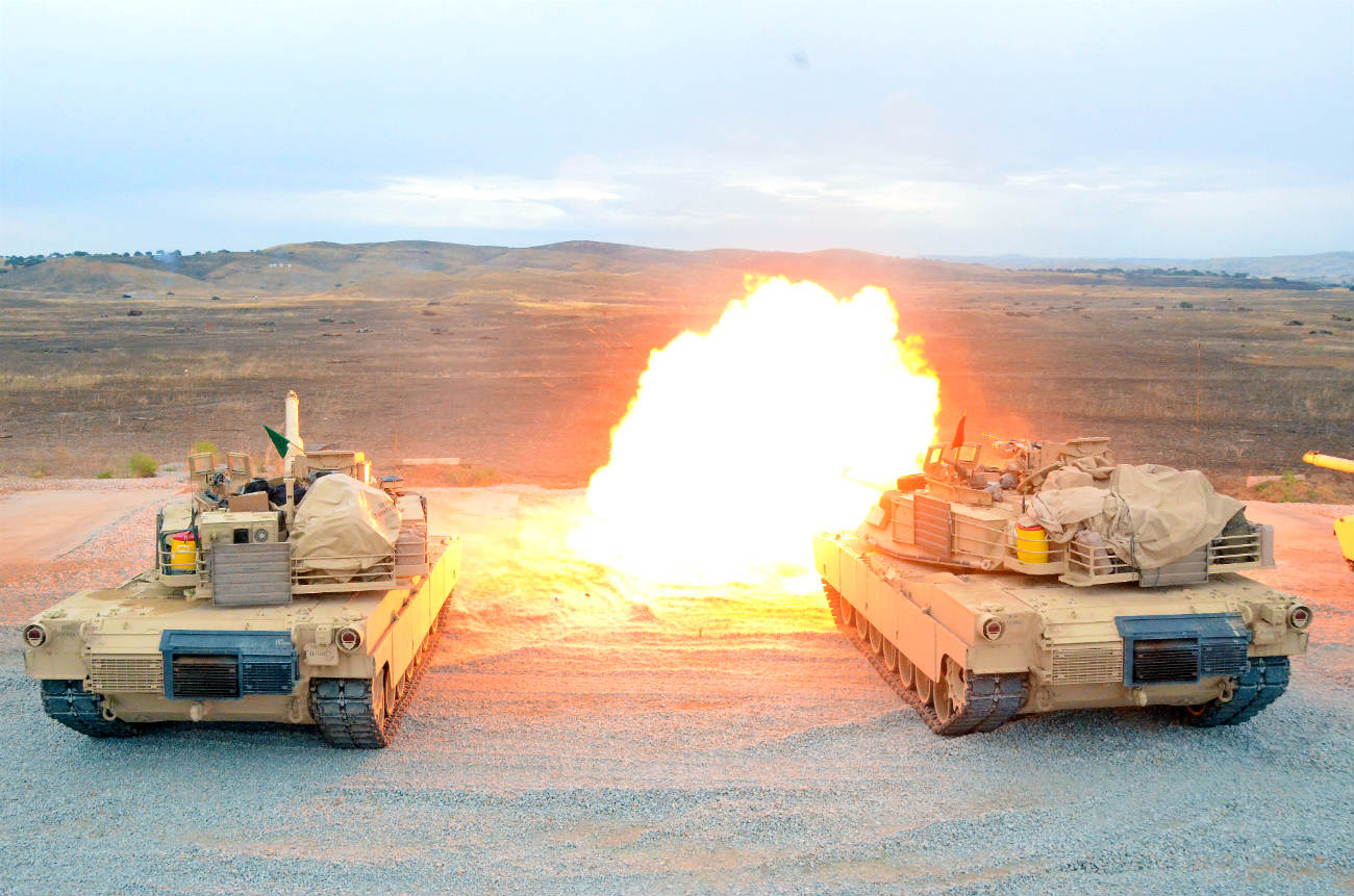M1 Tanks firing rounds