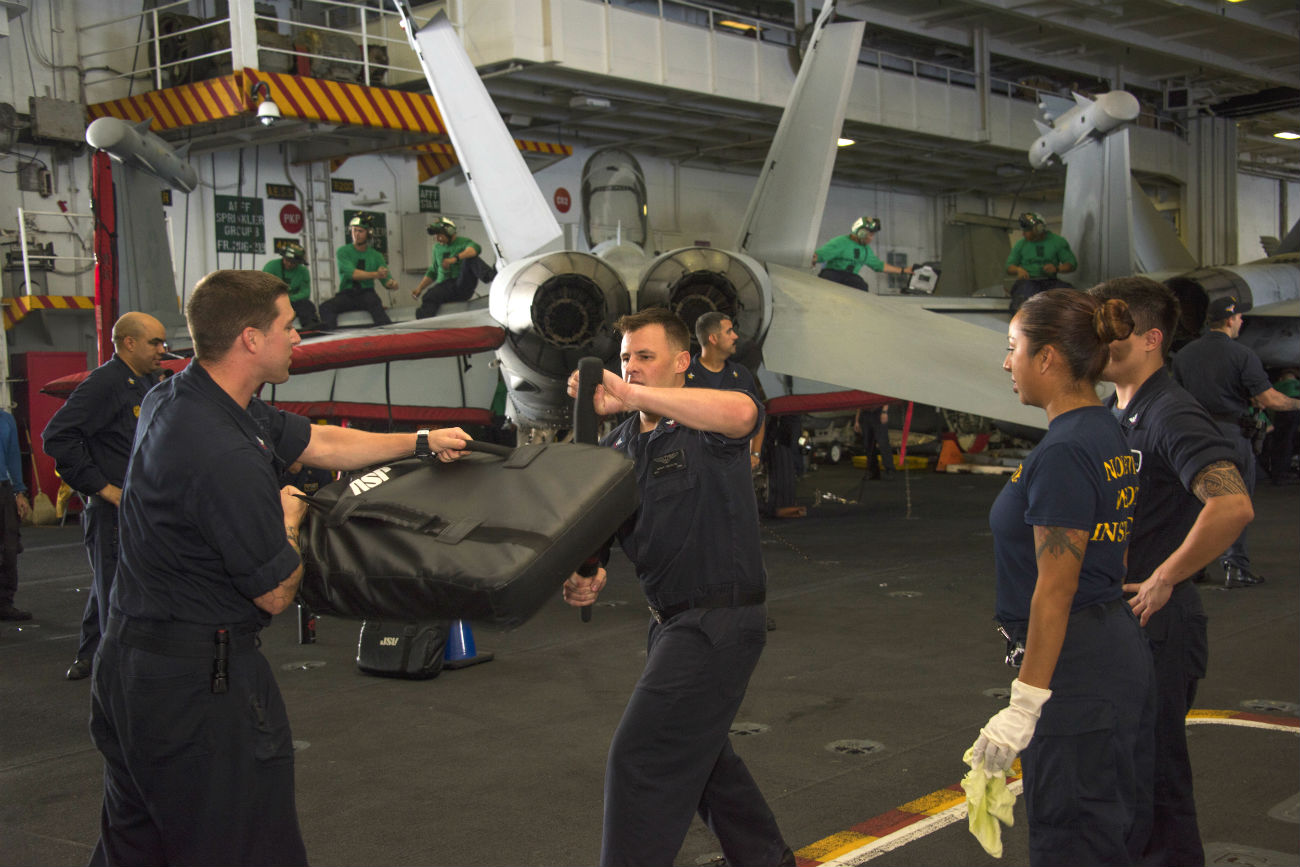 Navy men Close arms training aircraft carrier images