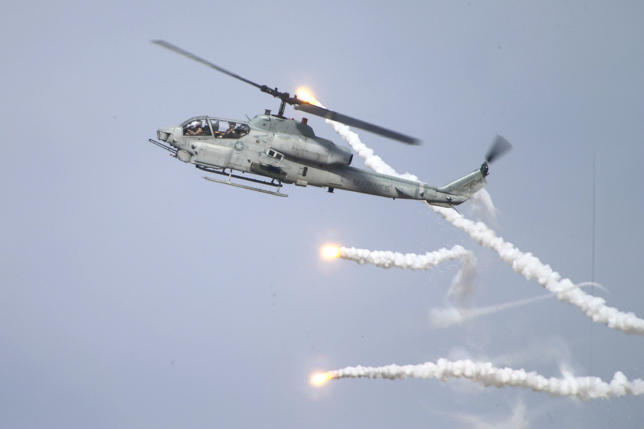bell AH-1 images fires missiles