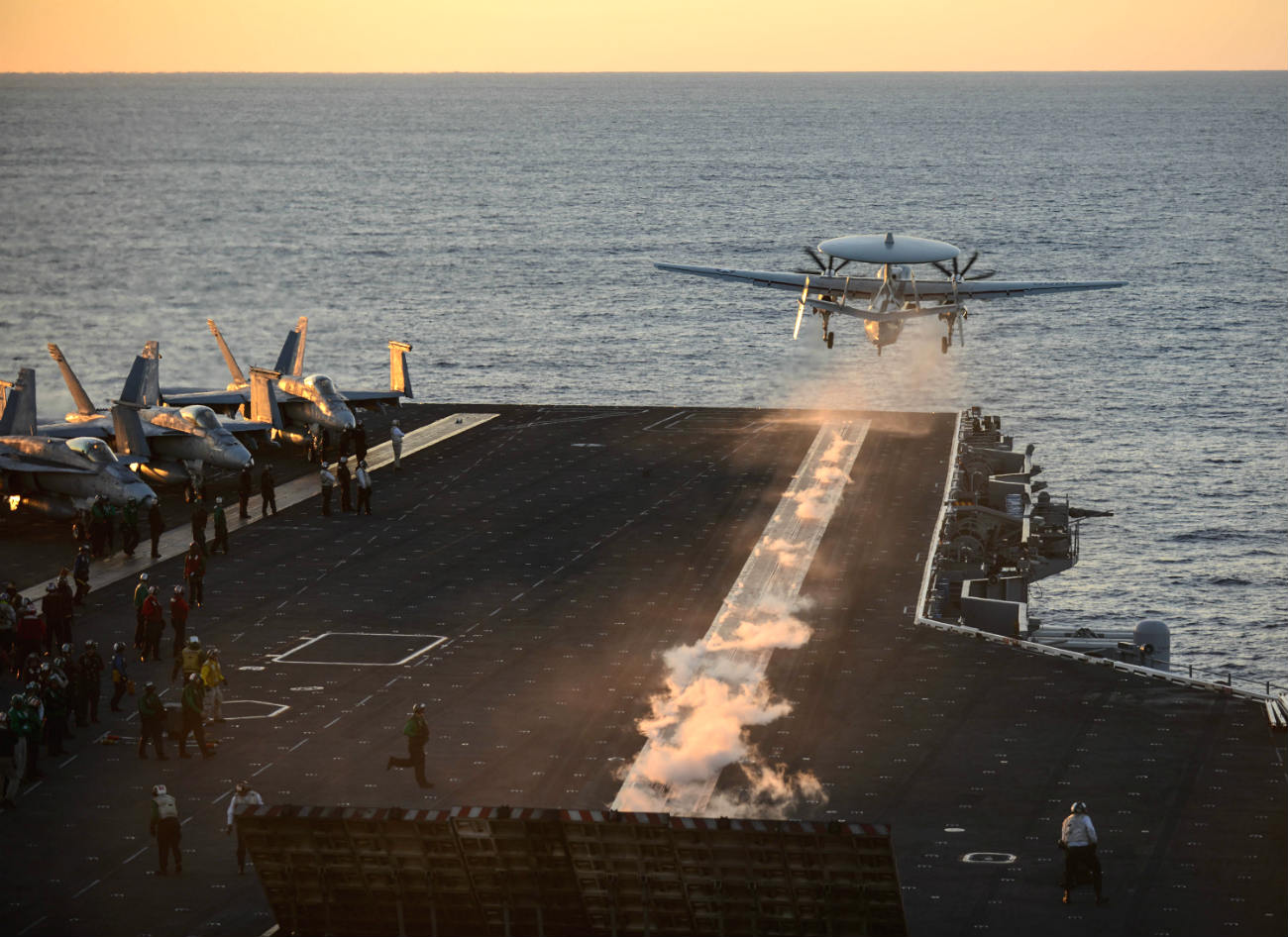 E-2 Hawkeye takes off sunset