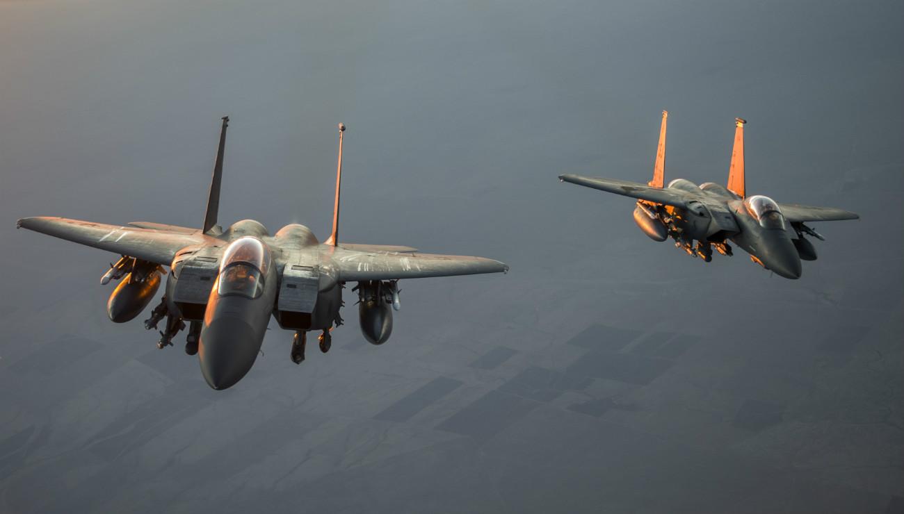 F-15 Eagles aircraft sunrise