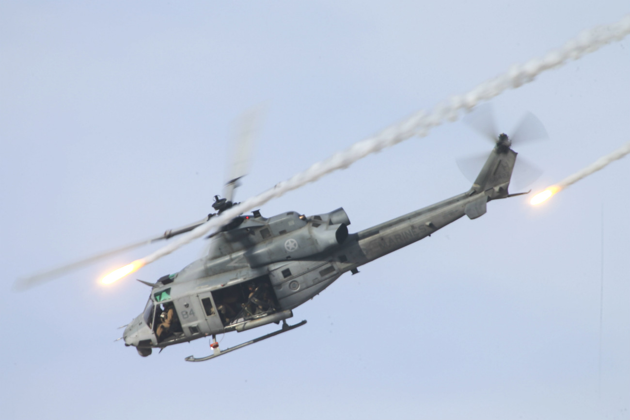 UH-1 Aircraft fires missiles