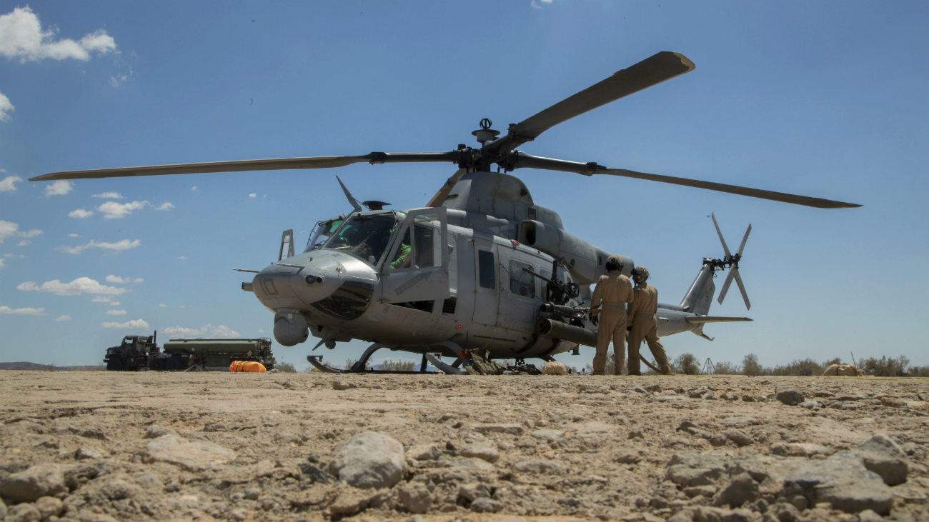 Bell UH-1 Images Helicopter Aircraft parked