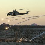 UH-1 Helicopter fires rounds