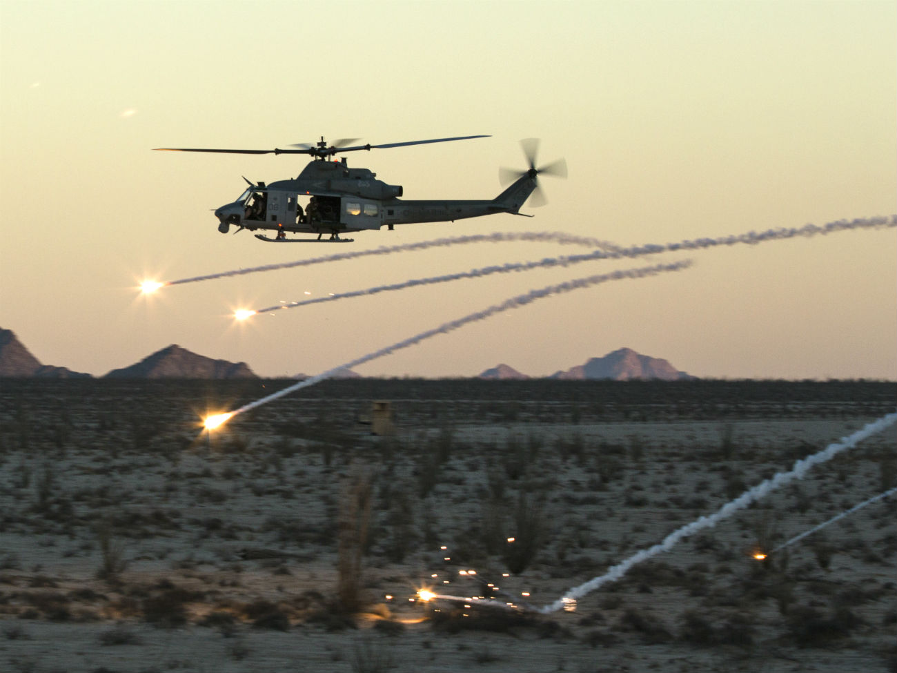 Bell UH-1 Images Helicopter fires rounds