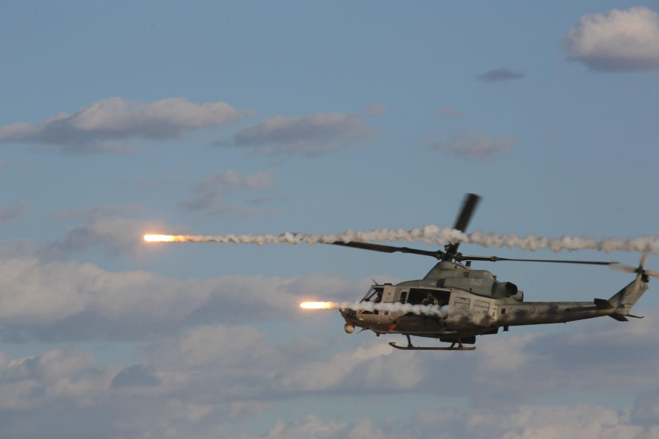 UH-1 Huey fires rockets