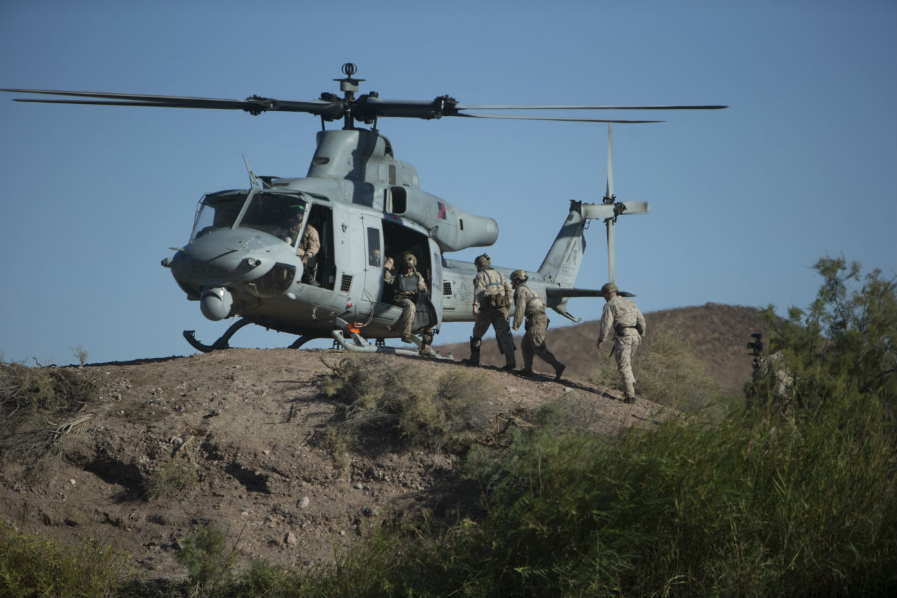 UH1 Helicopter loads Soldiers