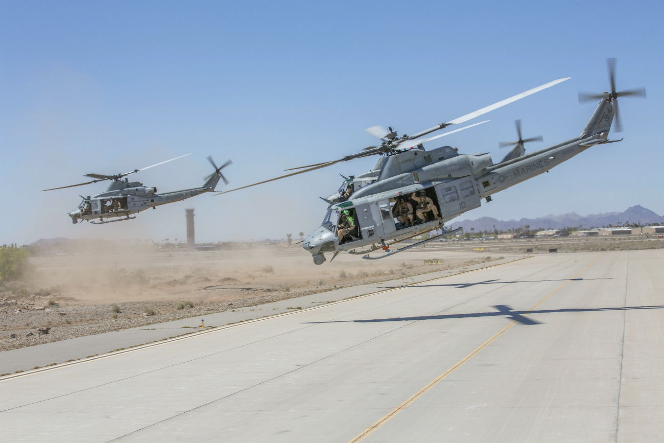 Uh-1 Helicopters take off