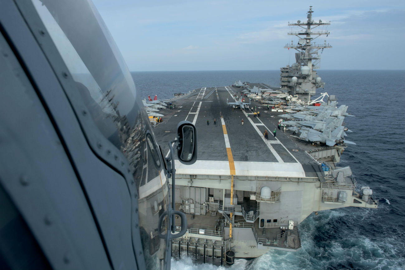 Helicopter landing on carrier US Aircraft Carrier images
