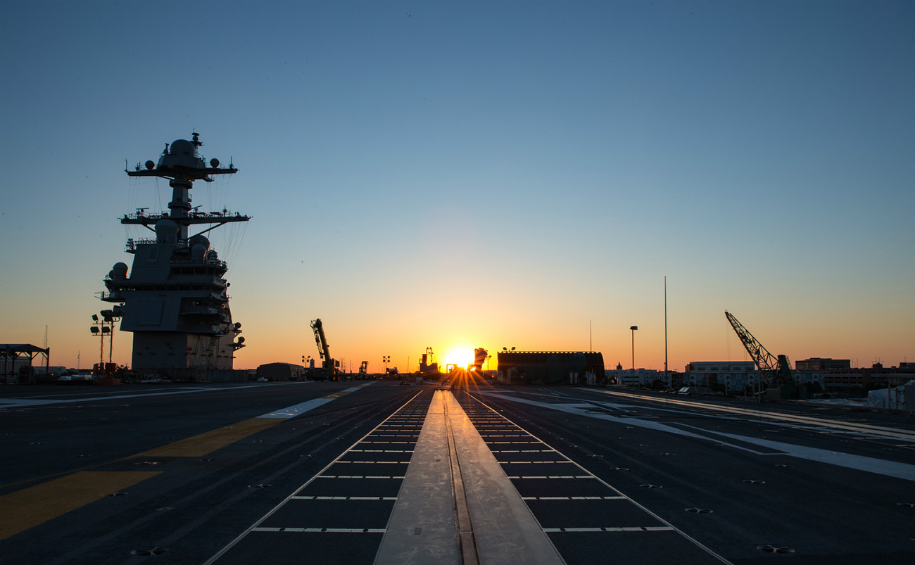 USS Gerald R Ford - The sun rises over PCU Gerald R Ford