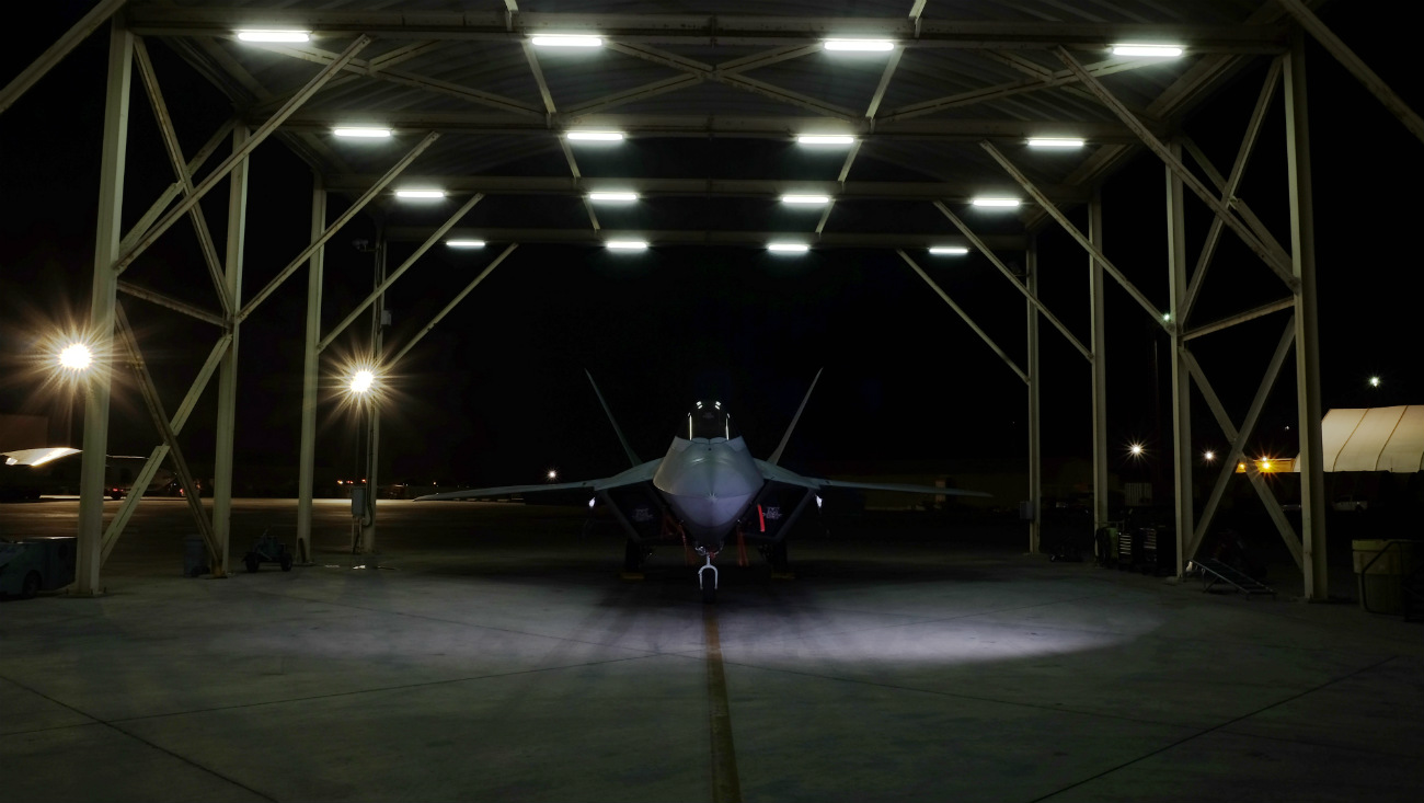 US Military Aircraft at Night Images - F-22A Raptor resting on the flight line