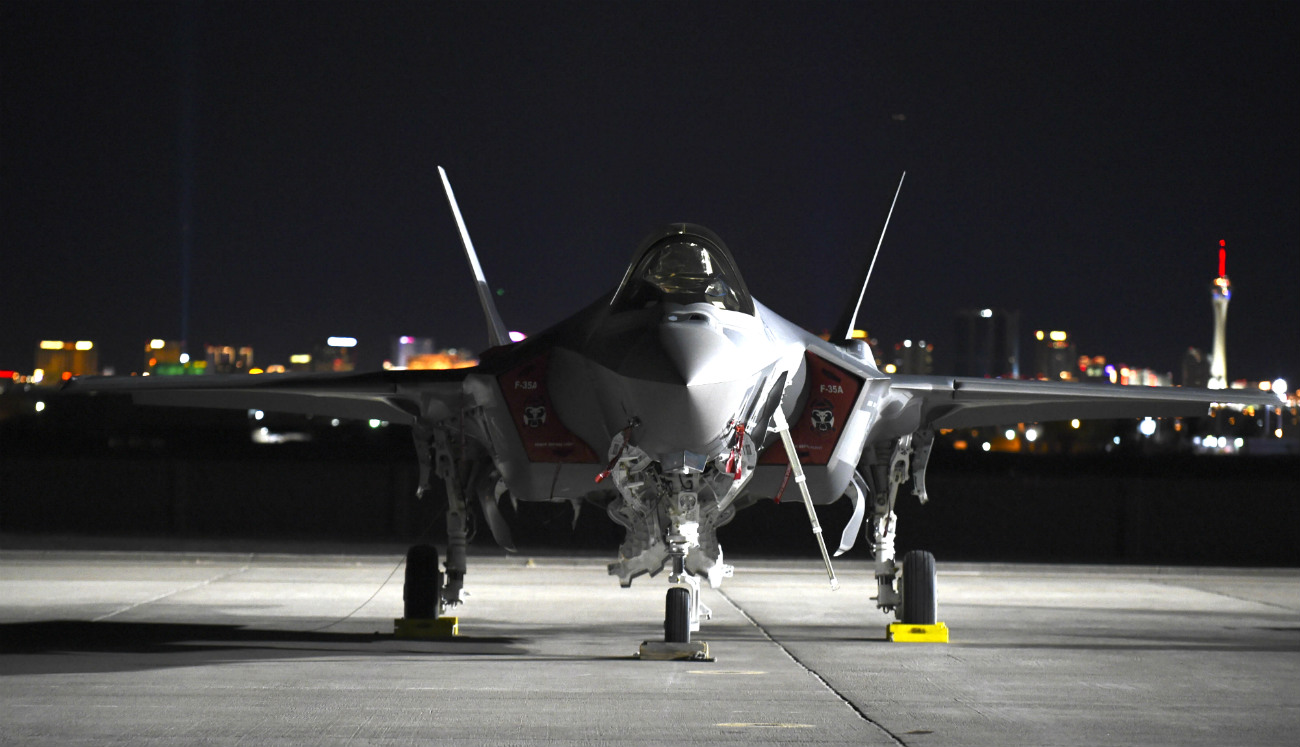 US Military Aircraft at Night Images - F-35A Lightning II sitting on the flight line