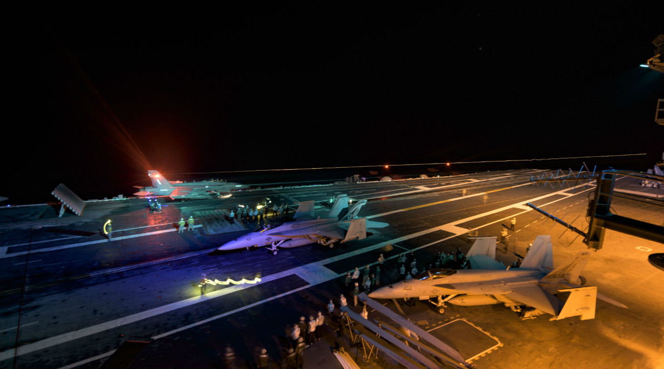 US Military Aircraft at Night Images - FA-18E Super Hornet launching from the flight deck
