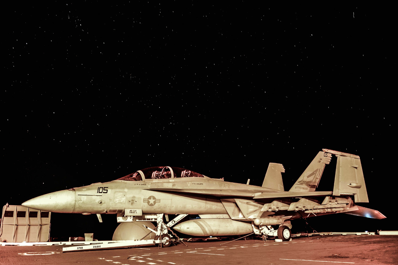 US Military Aircraft at Night Images - FA-18F Super Hornet sitting on the flight deck