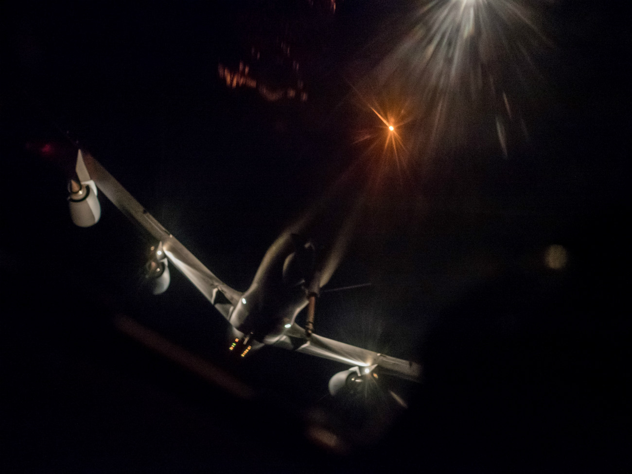 US Military Aircraft at Night Images - KC-135 Stratotanker preparing to aerial refuel