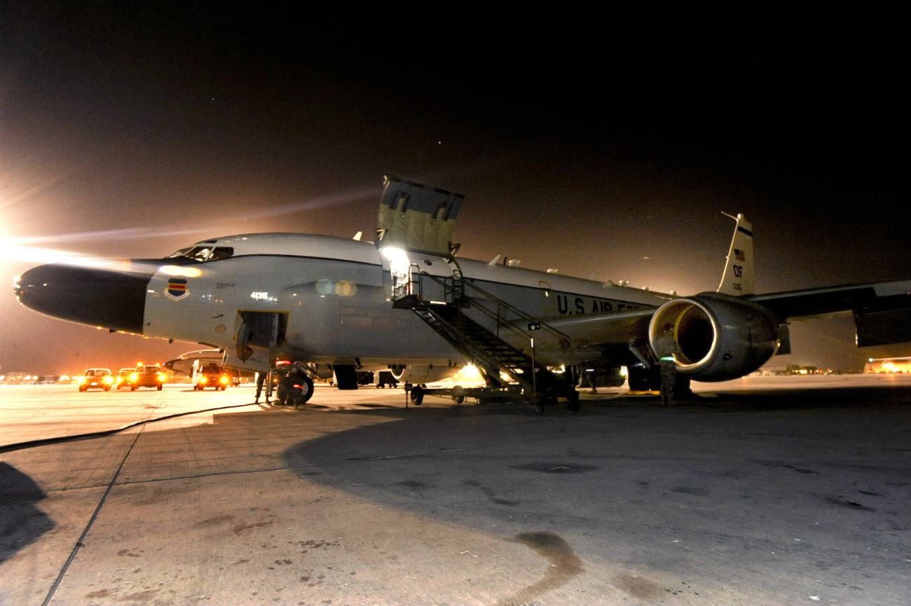 US Military Aircraft at Night Images - RC-135 Rivet Joint standing on the flight line