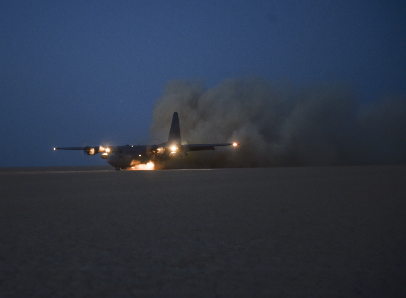 C-130 Hercules lands in a dry lake bed