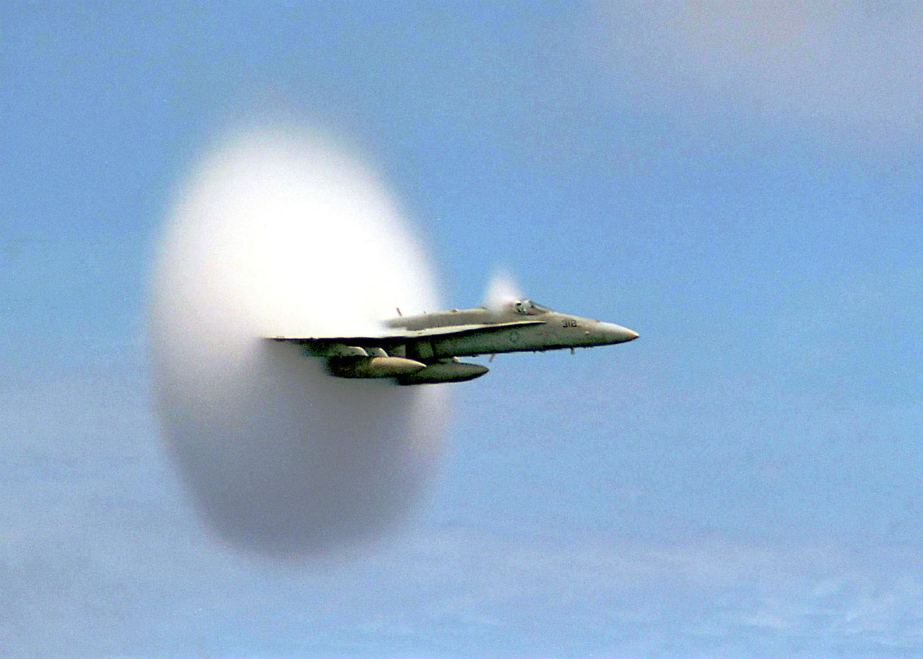 FA-18C Hornet breaking the sound barrier over the Pacific Ocean