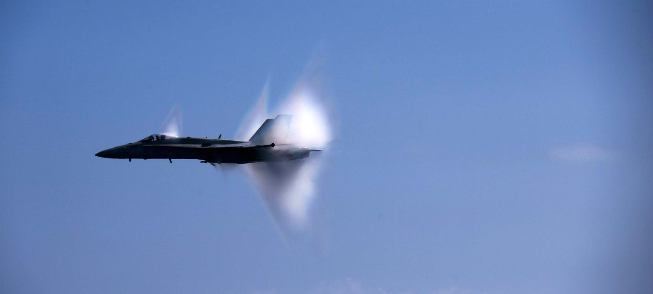 FA-18C Hornet breaking the sound barrier over the USS Carl VInson