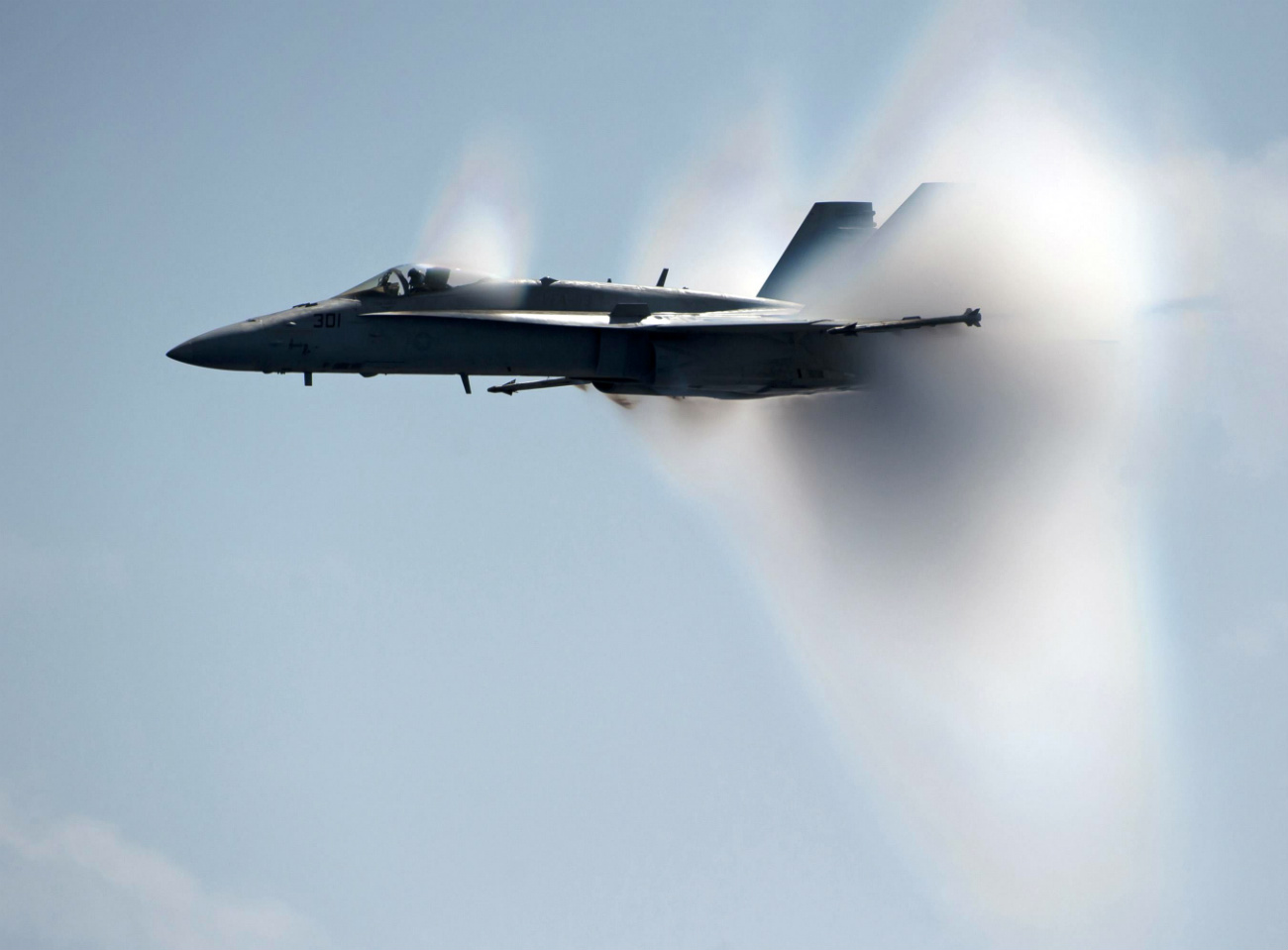 FA-18C Hornet breaks the sound barrier alongside the Nimitz-class aircraft carrier