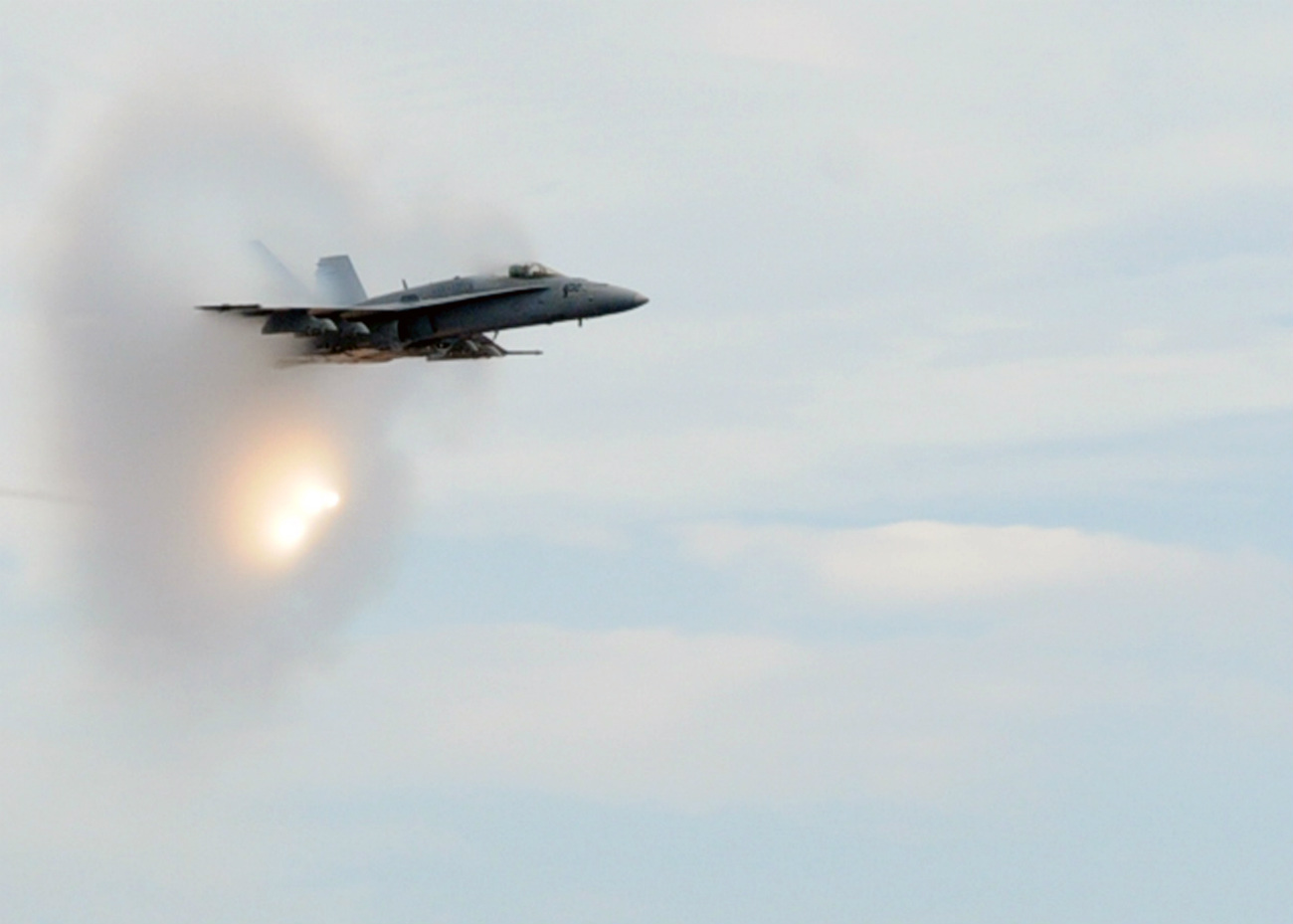 FA-18C Hornet dropping flares and breaking the sound barrier