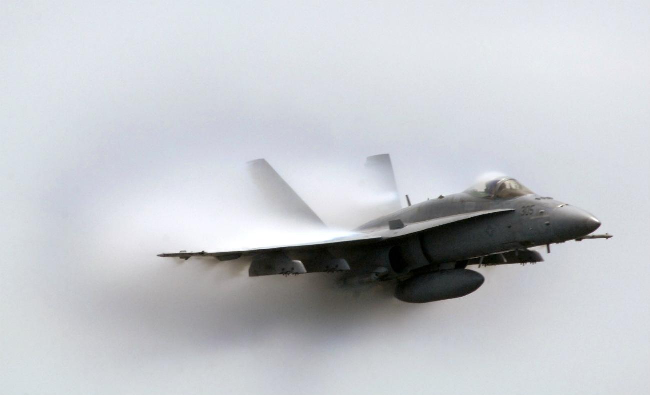 FA-18C Hornet punching through a cloud of water vapor