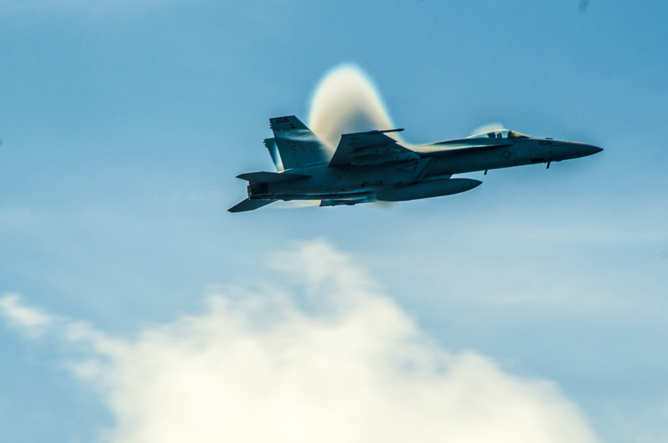 FA-18E Super Hornet breaks the sound barrier over the aircraft carrier USS George Washington