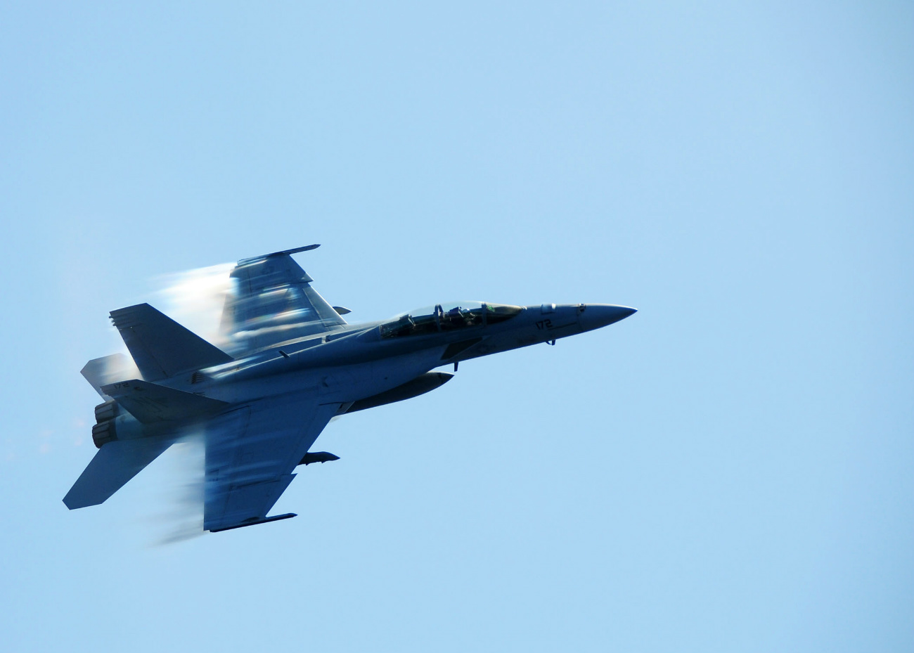Sound Barrier Breaking Images, FA-18F Super Hornet breaks the sound barrier during a fly-by of USS Ronald Reagan