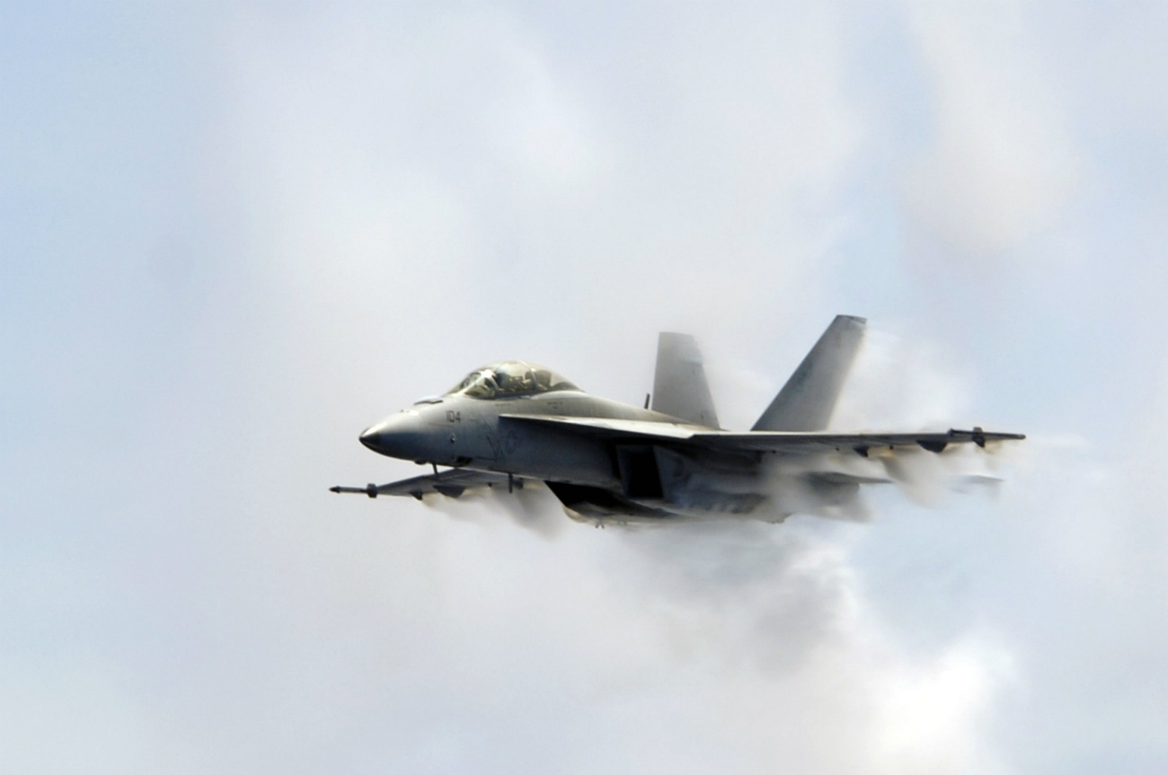 FA-18F Super Hornet punches through a cloud of water vapor while breaking the sound barrier