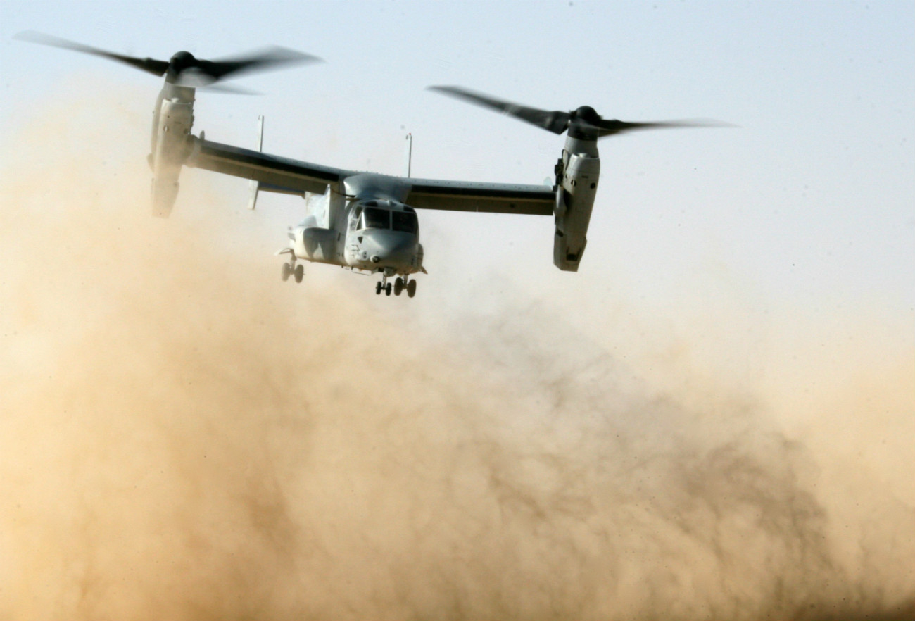 MV-22B Osprey kicks up a cloud of sand and dirt as it takes off