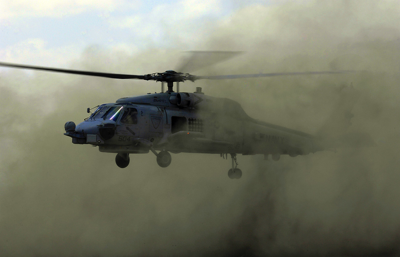 SH-60 Seahawk sets off dust and dirt as it lands