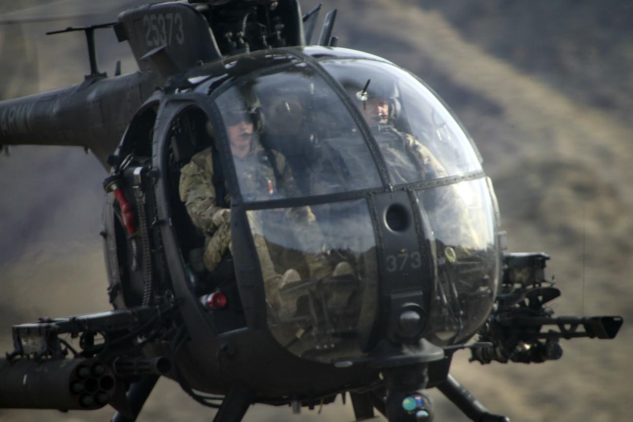 MH-6 Little Bird flying over designated targets
