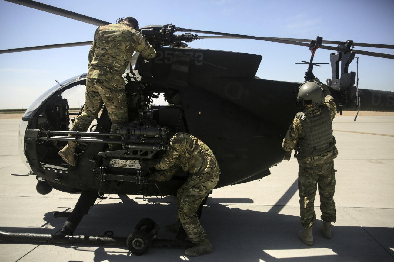 MH-6 Little Bird preparing for transport