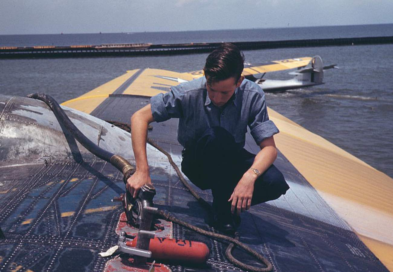 Sailor refueling, colorized WWII photos