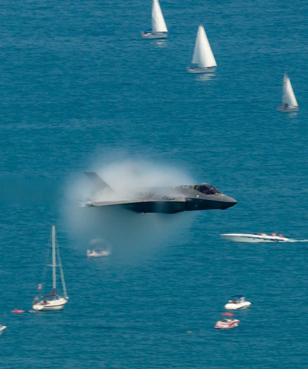 F-35 over sailboats