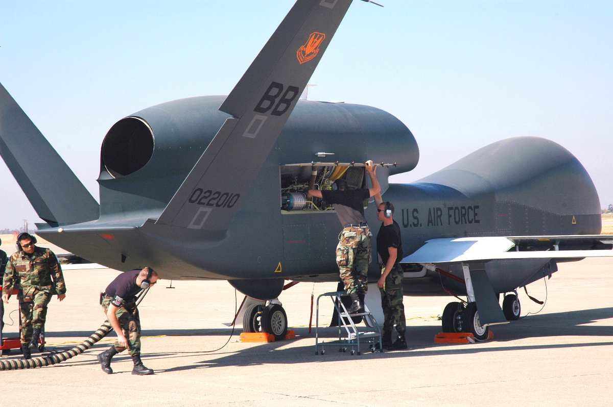 Avionics specialists with the 12th Aircraft Maintenance Unit prepare a Global Hawk for a runway taxi test at Beale Air Force Base, California. The Global Hawk is scheduled to begin flying at Beale in early November. The program is a total force effort with the Air Force Reserve's 13th Reconnaissance Squadron assisting active duty personnel.