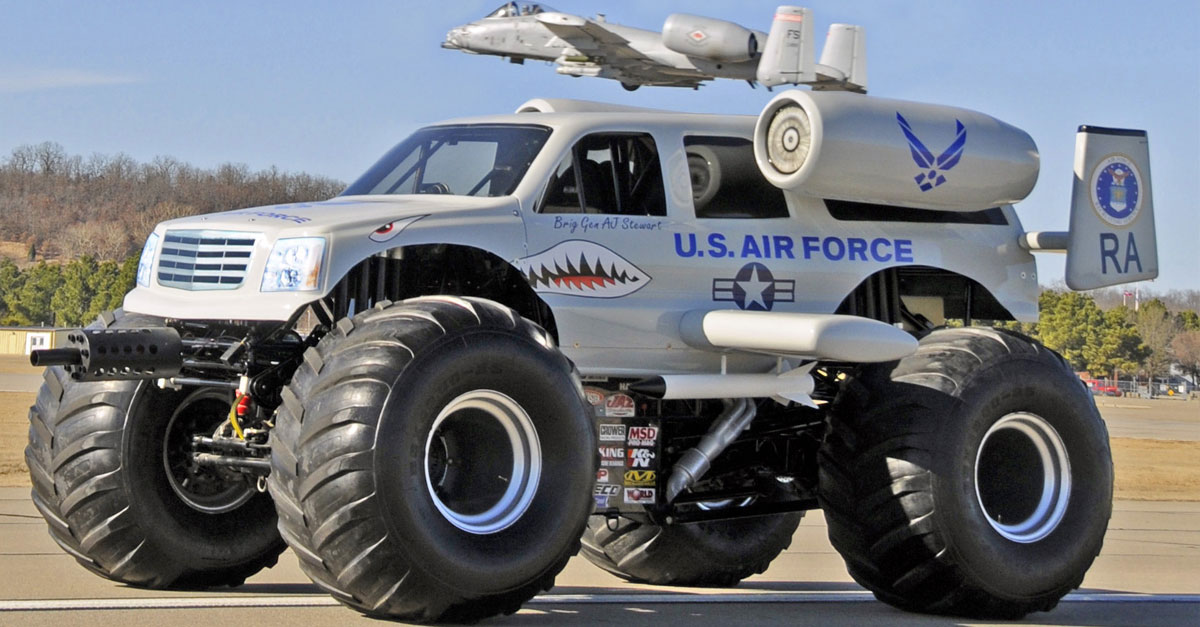 A-10 Warthog flies over an A-10 monster truck above the runway at the Fort Smith (Ark.) Regional Airport