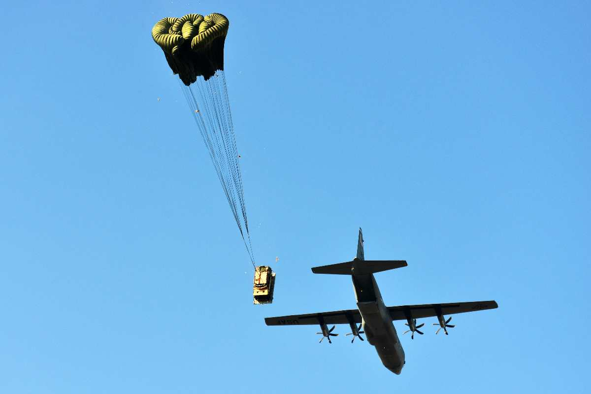 A U.S. Air Force 86th Air Wing C-130 Hercules airdrops a Humvee assigned to the 173rd Airborne Brigade Combat Team onto Frida IV Drop Zone in Pordenone, Italy, Jan. 21, 2016.