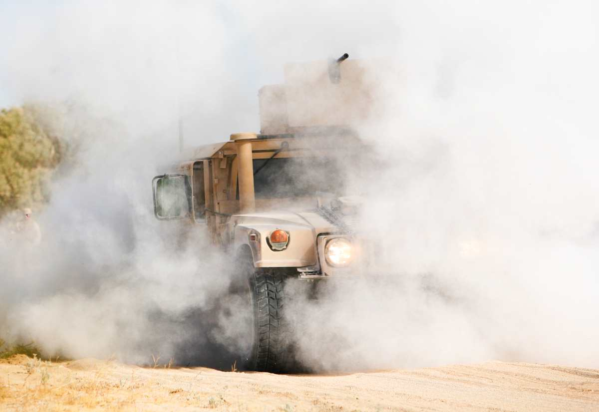 U.S. Marine Corps Humvee kicking up dust.