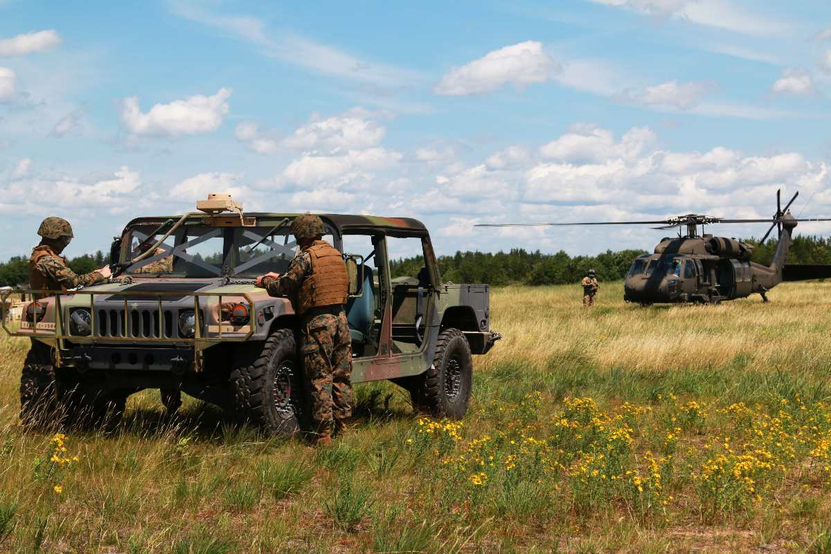 Members of the U.S. Marine Corps Forces Reserve Landing Support Company, Combat Logistics Regiment 45 prepare a high mobility multipurpose wheeled vehicle (HMMWV) for sling load operations during Northern Strike 19 on Camp Grayling, Michigan, July 21, 2019. Northern Strike 19 is a National Guard Bureau-sponsored exercise uniting service member from more than 20 states, multiple service branches and numerous coalition countries during the last two weeks of July 2019 at the Camp Grayling Joint Maneuver Training Center and the Alpena Combat Readiness Training Center.